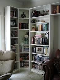 tall white corner bookcase with three sides of captivating designs