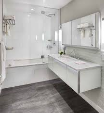 maple bathroom cabinets with contemporary dark gray floor tile