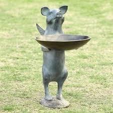 flying winged pig birdfeeder whimsical metal garden sculpture