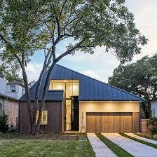 Austin Houses by Design Hound Hides Second Storey Of Austin Home Behind Faceted Roof