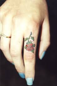 little flower tattoo on finger tattoo designs tattoo pictures