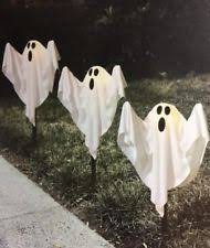 set of 3 glowing ghosts lighted spooky figures outdoor