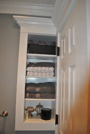 custom storage built in behind door small bathroom storage for