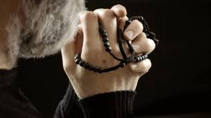 religion pray rosary believer a faithful a believer