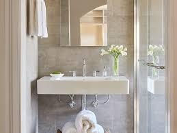 bathroom clean contemporary framed glass shower neutral tile tile
