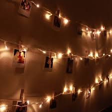 lights on wall with pictures diy polaroid wall with string lights simple stylings now you have