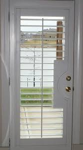 hunter douglas heritance wood shutter with french door cutout