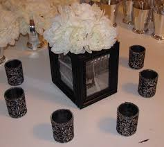 Black And Silver Centerpieces by I Like The Picture Frames And Candles As A Centerpiece