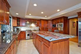 kitchen wooden cabinet ceiling light wooden floor granite table