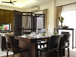 dark brown wooden dining set on the carpet connected by black