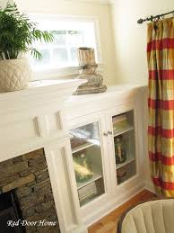fireplace built in cabinets red door home built in cabinets the details