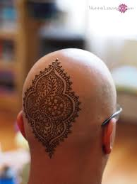 henna tattoo on man back head