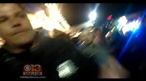 shows officer confronting filming arrests in towson