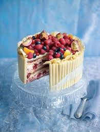 white chocolate layered celebration cake berries party