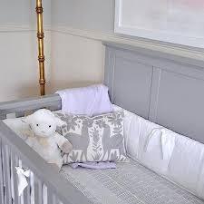 gray nursery dresser with quatrefoil mirror transitional