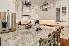 Ivory Colored Kitchen Cabinets White Backsplash Heeringbone Design Behind Stove Dark Hardware