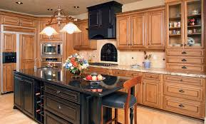 maple cabinets with black island a combo i have been considering dark stained island with light