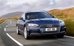 audi audi a5 review handsome looks but can it beat bmw and mercedes