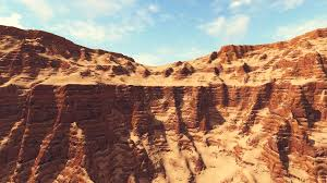 red striped cliffs in a canyon under blue cloudy sky during