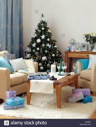 modern livingroom at christmas with cream furniture and turquoise