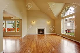 High Ceiling Living Room by Spacious Living Room With High Ceiling Big Arch Window Fireplace