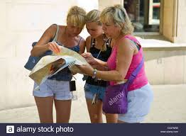 Catalonia Spain Map by Women Tourists Studying Map On Street In Barcelona Catalonia Spain
