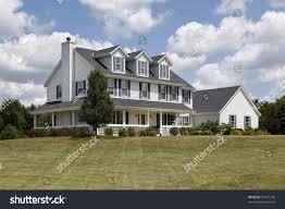 white suburban home blue shutters wraparound stock photo 37067740