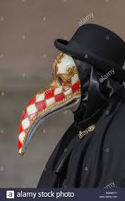venetian bird mask person with venetian bird mask wearing a bowler hat venice italy