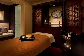 a spa treatment room at the peninsula shanghai spa by espa