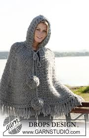 drops design poncho drops poncho with and pompoms in 2 threads eskimo size s