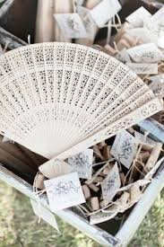 fan favors prepare fans for your guest at an outdoor summer wedding ben yew