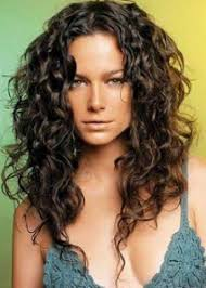 medium length hairstyles naturally curly hair layered haircuts for