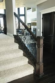 metal landing banister and railing wood and metal railing with carpeted stairs stairways