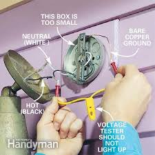 how to install flood lights how to choose and install motion detector lighting the family handyman