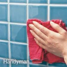 how to clean the bathroom tiles how to regrout bathroom tile fixing bathroom walls family handyman