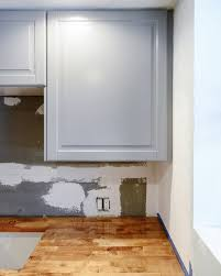 how to fix kitchen base cabinets to wall how to install cabinet filler strips