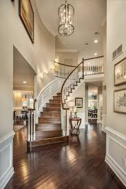 Foyer Lighting For High Ceilings Traditional Entryway With Wainscoting High Ceiling Chandelier