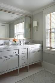 Dual Illuminated Vanity Mirrors Gray Dual Footed Vanity With Gray Mosaic Tile Floor Transitional