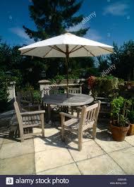 Outdoor Wooden Garden Furniture Wooden Garden Furniture Table U0026 Chairs U0026 Sun Shade Umbrella Stock