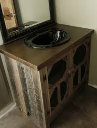 mens bathroom vanity made from barnwood cabinet with a concrete