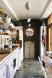 galley kitchens with white cabinets with butcherblock countertop