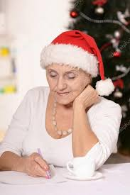 what to get an elderly woman for christmas elderly woman with gift stock photo aletia 56806251