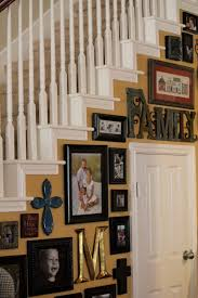 staircase ideas but along the wall of the stairs gallery walls