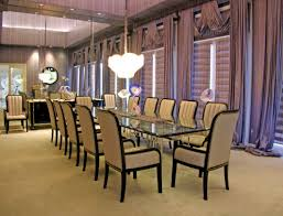 formal dining room drapes with modern chandeliers and wall