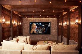 amazing wooden home theatre with cozy seating and pillows at