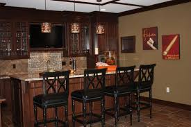 dark interior nuance of home basement bar design with catchy wall