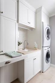 Laundry Cabinet With Hanging Rod Best 25 Laundry Folding Station Ideas On Pinterest Laundry