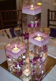 water centerpieces anyone did floating water candle with vases as their centerpieces