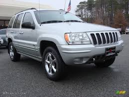 light gray jeep 2002 bright silver metallic jeep grand cherokee overland 4x4