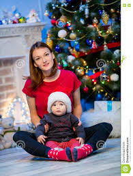 happy family among christmas decorations at home stock photo